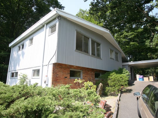 The exterior of this 1957 mid-century modern home in Rye Brook is undergoing a makeover.  Here it is pictured July 22, 2014.