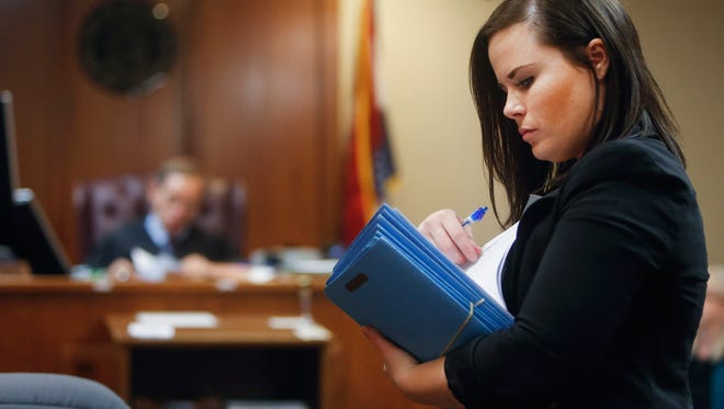 Public defender Dawn Calvin looks through her case files while in the courtroom on Thursday, Oct. 20, 2016.