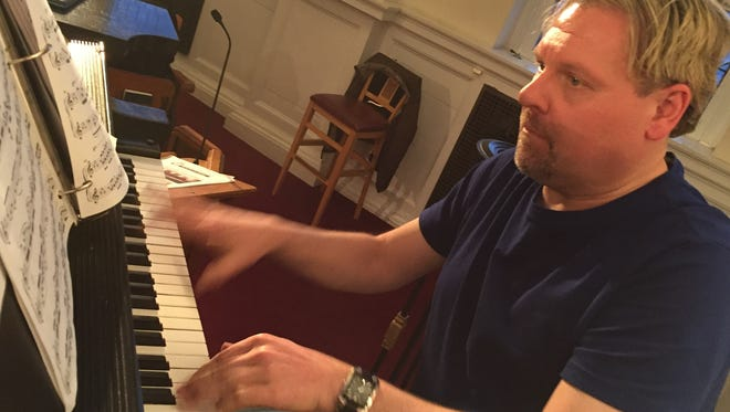 Brian Helman at the piano during practice for a free spring concert by the CVSM String Orchestra Tuesday, March 28