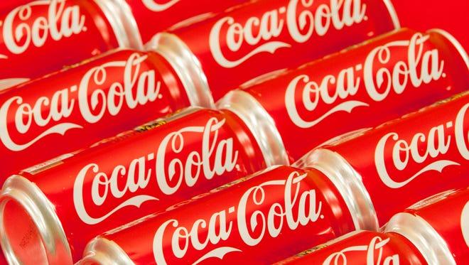 Bottle tops of Coca-Cola 8 oz. bottles are shown in Doral, Fla.