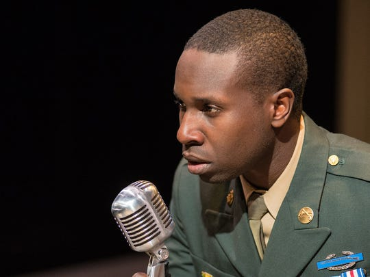 "Andrew Muwonge portrays a returning veteran on Christmas Eve in Next Act's ""UnSilent Night."""