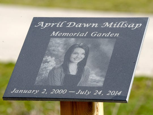 The April Dawn Millsap Memorial Garden, with her image on a plaque, is at the corner of Depot and South Fulton in Armada along the Macomb Orchard Trail.