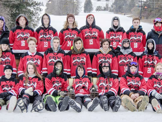 The Milford boys and girls snowboarding teams just