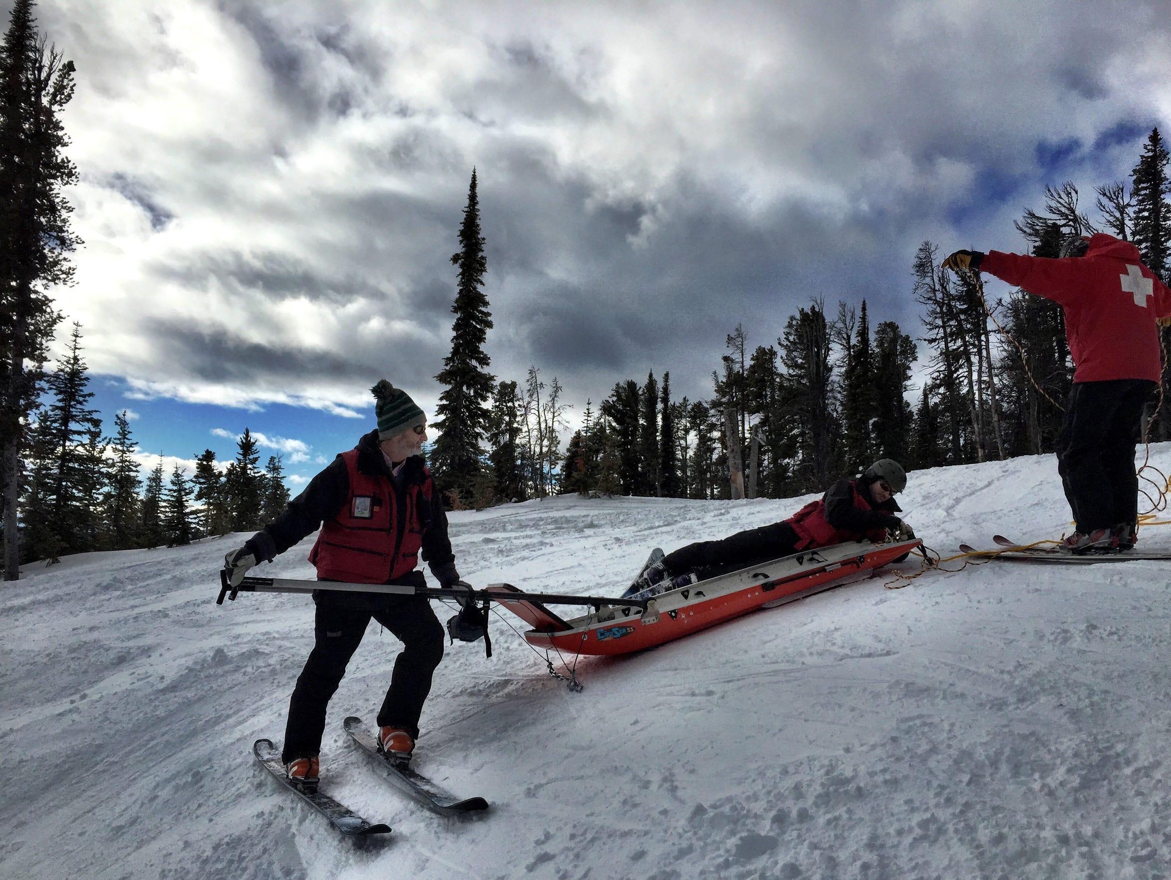 Great Falls Ski Patrol members ready the toboggan before