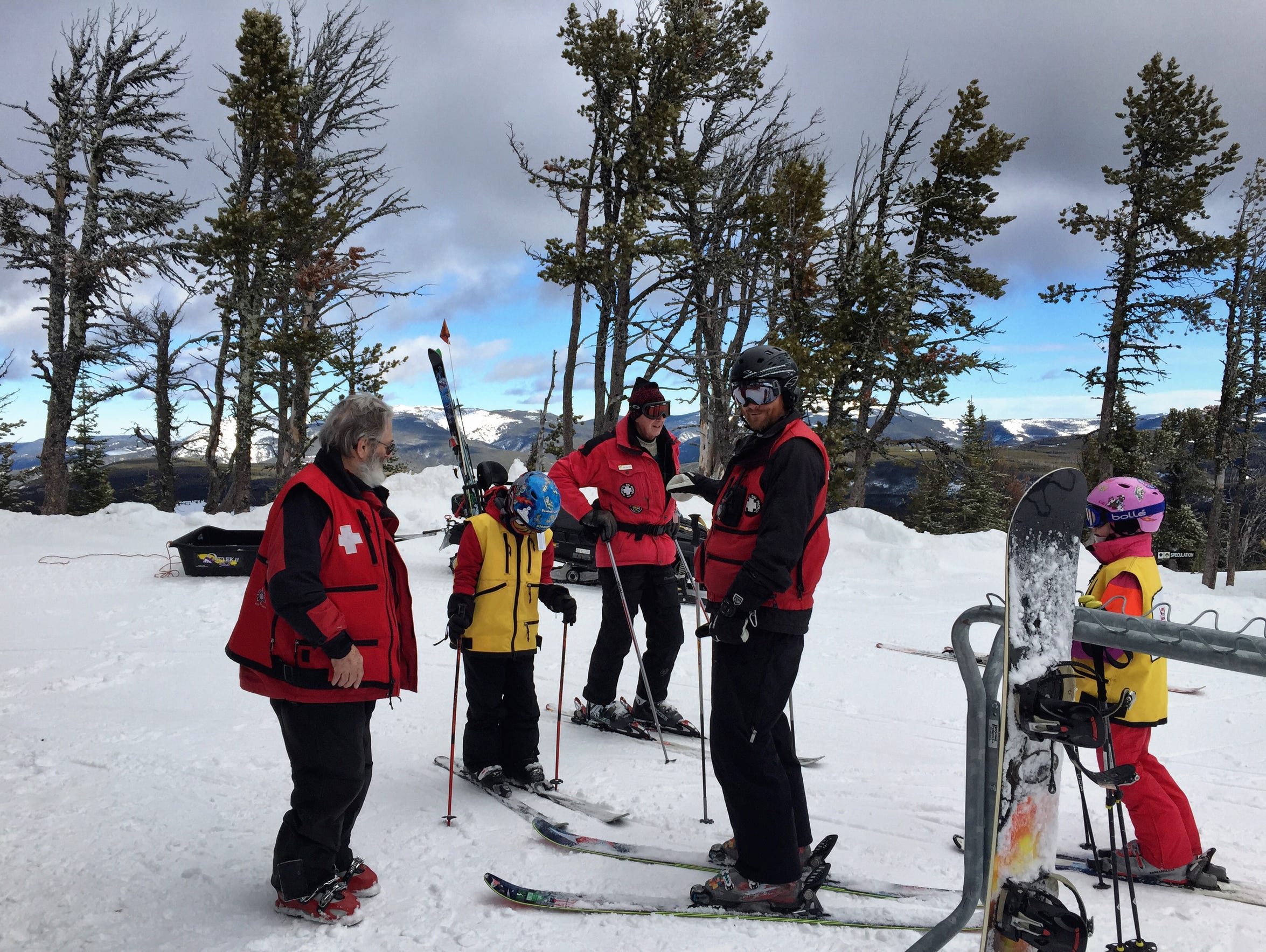 Great Falls Ski Patrol gathers at the top of Showdown.