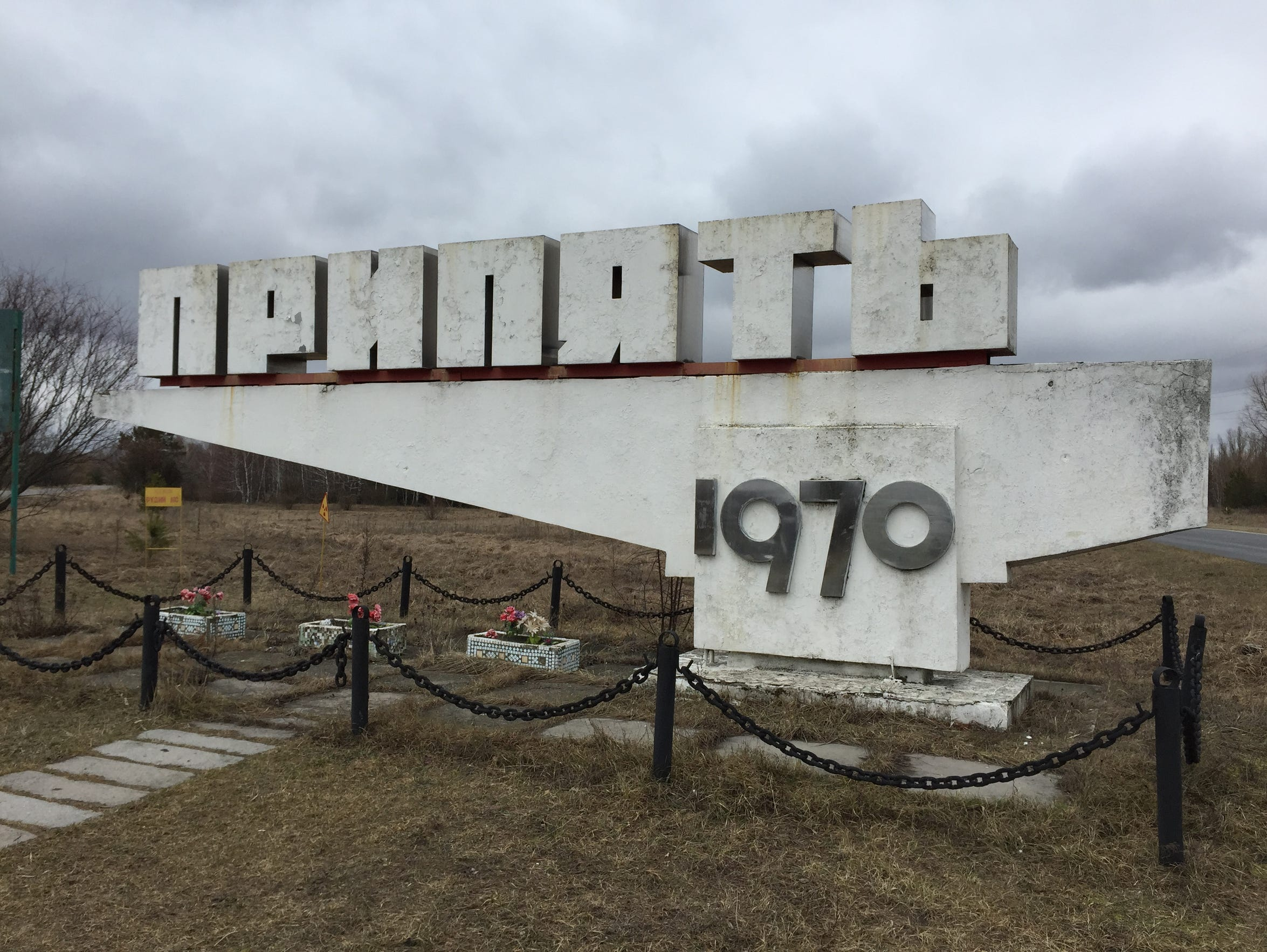 A sign marks the entrance to the abandoned city of