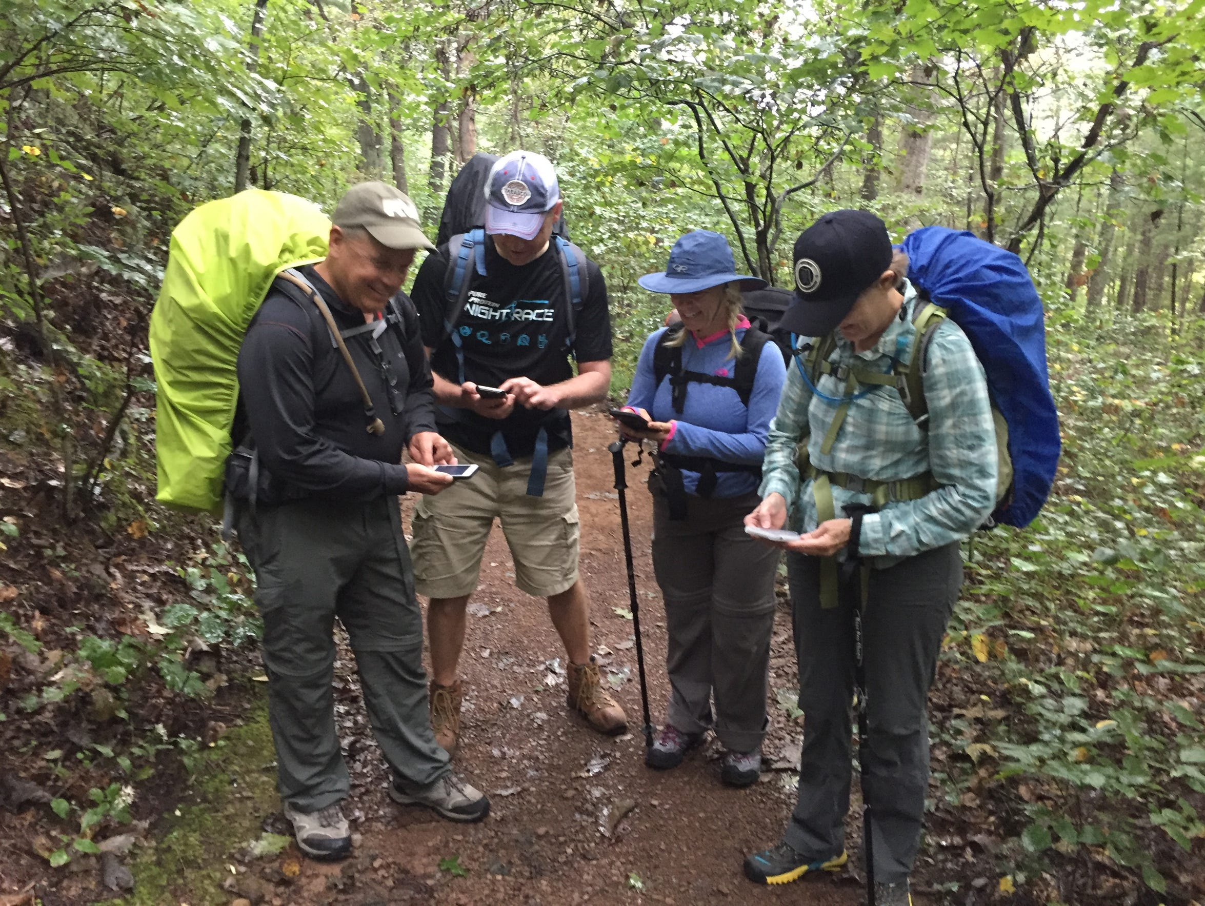 Fellow hikers check their Appalachian Trail apps before