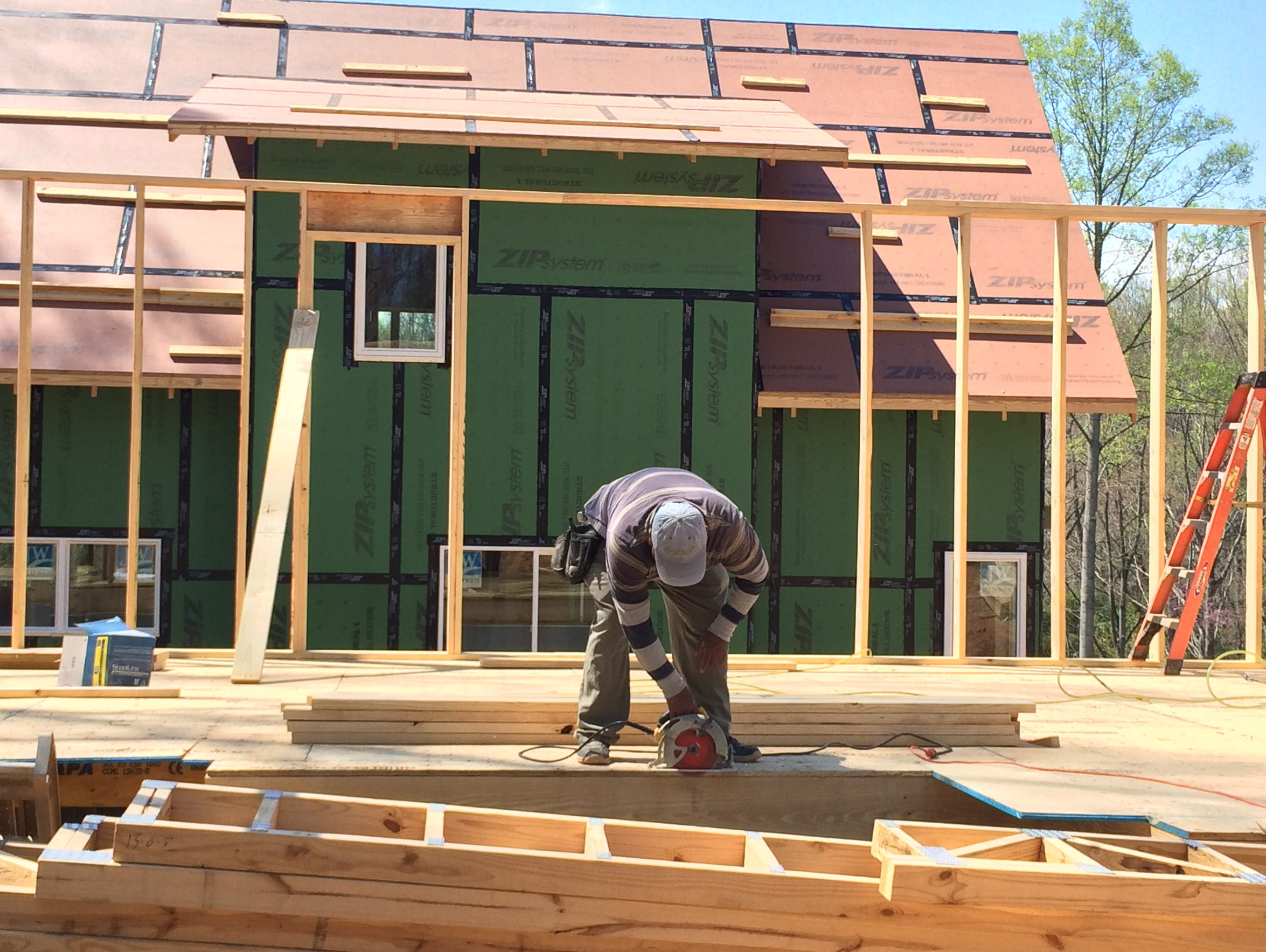 Juan Lopez of JAG Construction works on a new home