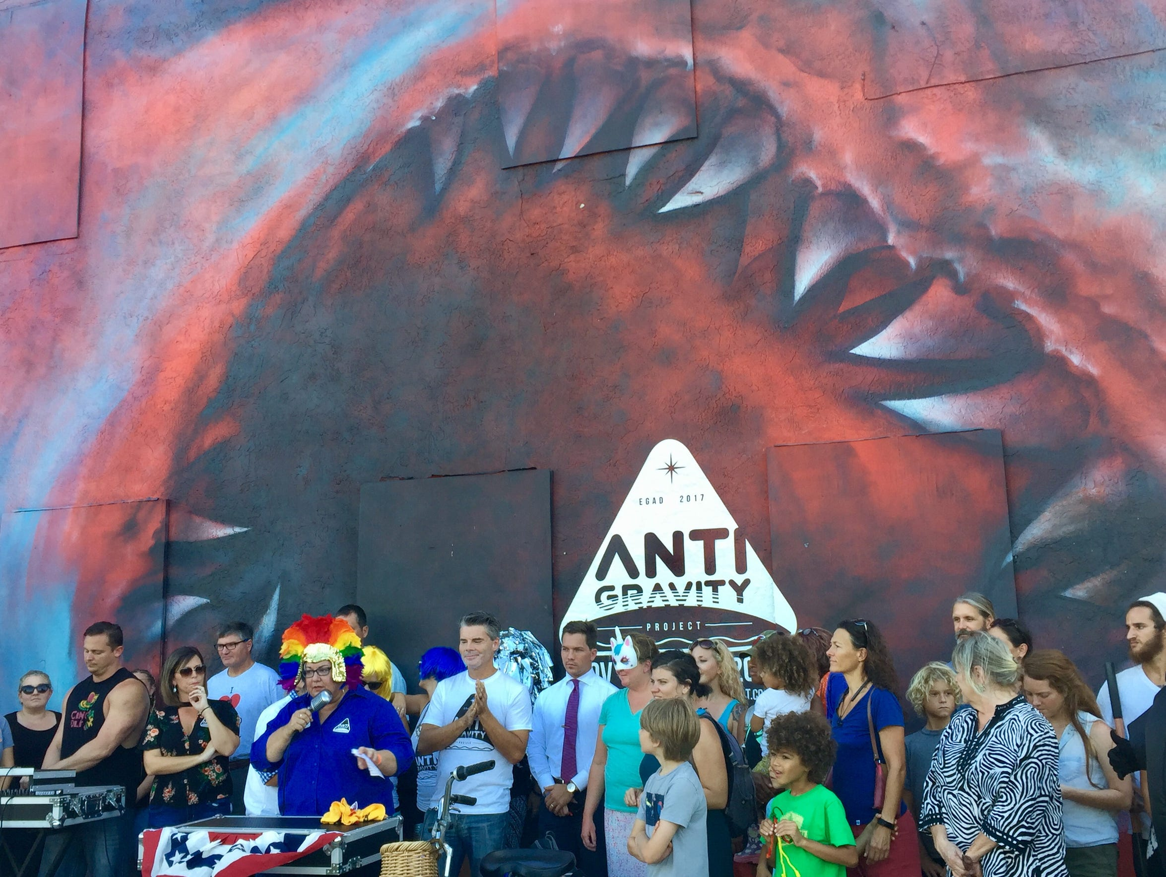 Derek Gores (center, wearing a white T-shirt) co-announced creation of the Anti-Gravity Project during a September press event next to Shark Toof's mural in Eau Gallie.
