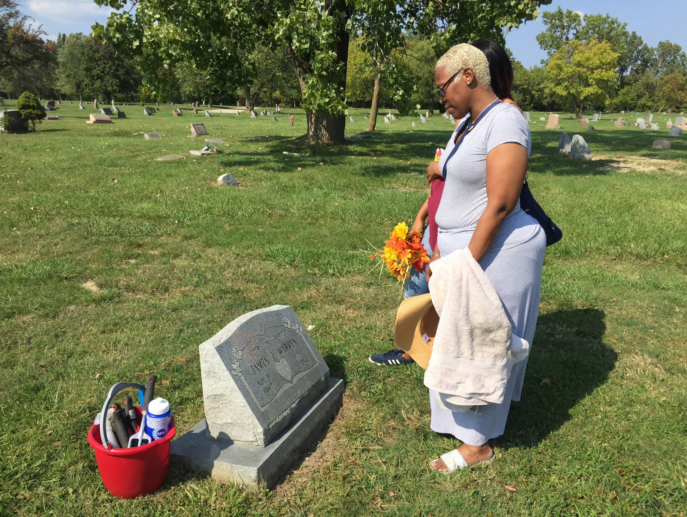 Valencia Warren-Gibbs visits the gravesite of her brother