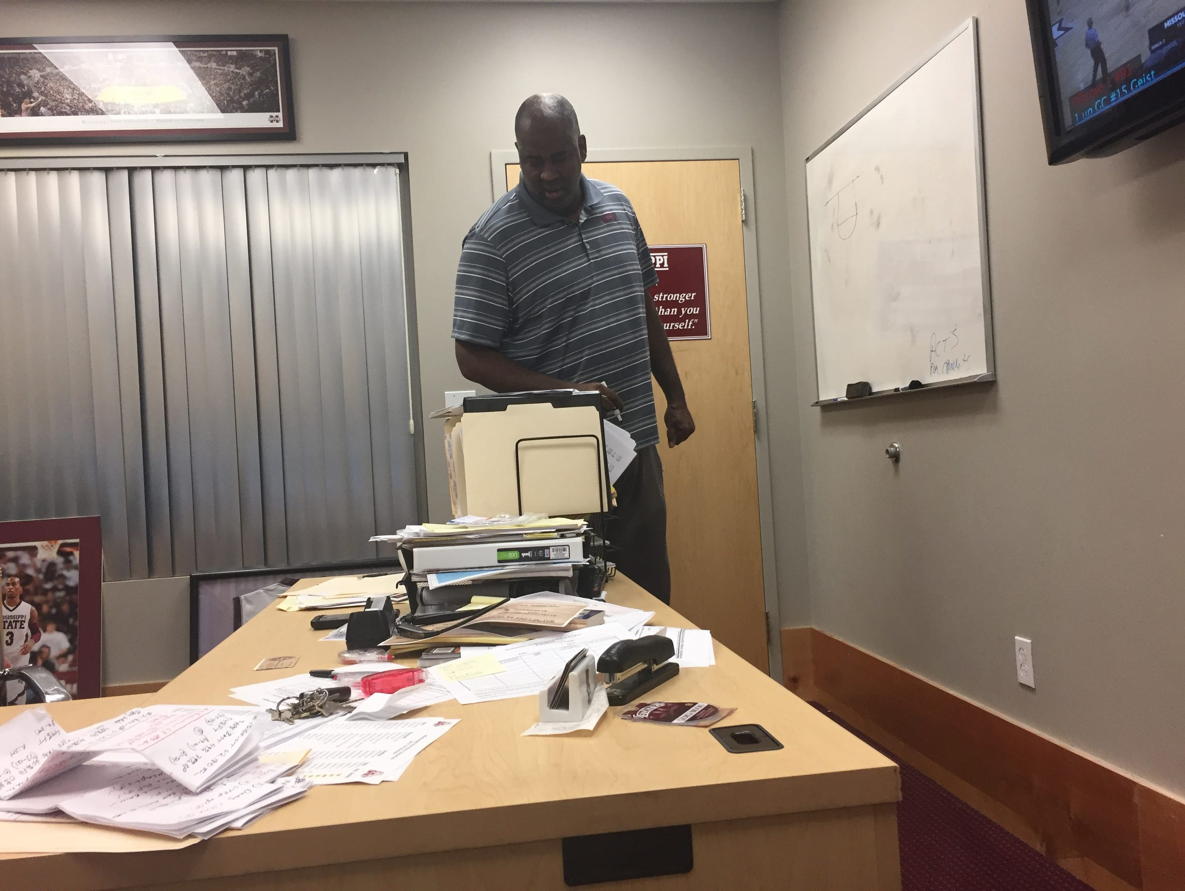 George Brooks goes over plays in his office.