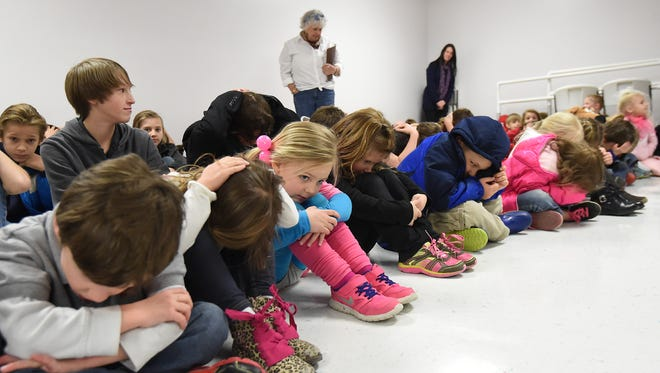 Students at Mountain Home Christian Academy take part in a tornado drill on Thursday.