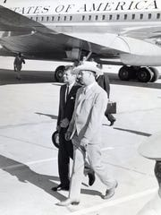 Mayor Frank Bogert greets Pres. John F. Kennedy at Palm Springs Airport.