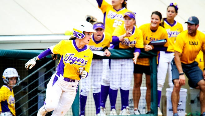 """LSU junior first baseman Sandra Simmons rounds first base on her way to a triple as her teammates cheer her on during the Super Regional last weekend. Simmons said the Lady Tigers """"have worked their entire life for this moment"""" as they prepare to play in the Women's College World Series."""