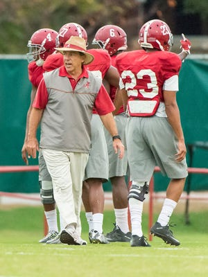 Alabama football coach Nick Saban works with his players during practice Nov. 2, 2015, in Tuscaloosa, Ala.