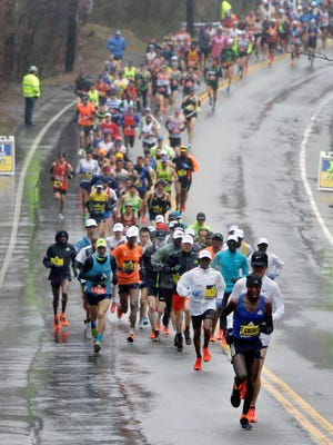 Evans Chebet, of Kenya, leads the men's elite field of runners at the one-mile mark of the 122nd Boston Marathon on Monday, April 16, 2018, in Hopkinton, Mass.