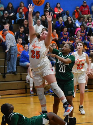 Kinston's Sherice Jones draws the charge against RHS' Gracyn Hall as Taliyah Jones applies pressure from behind in the fourth round of the 2-A state playoffs last season. Hall and the Tigers won their 2021 first-round game, 72-47, over Midway on Tuesday. [Paul Church/The Courier-Tribune]