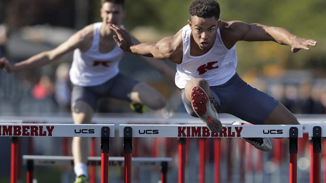 Kimberly's DJ Stewart wins the 110-meter hurdles during the WIAA Division 1 track and field regional meet at Papermaker Stadium at JR Gerritts Middle School. See more photos at postcrescent.com.