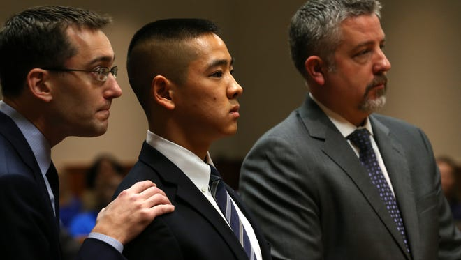 Charles Tan in court with defense lawyers James Nobles (right) and Brian DeCarolis during his 2015 murder trial in Monroe County.
