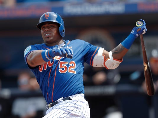 FILE - In this March 7, 2018, file photo, New York Mets left fielder Yoenis Cespedes (52) bats against the New York Yankees in a spring training baseball game , in Port St. Lucie, Fla. Mets captain David Wright won't participate in baseball activities for two months because of back and shoulder issues, another setback in his attempt to return from injuries that have sidelined him for two years,  and New York star outfielder Yoenis Cespedes is sidelined after hurting a wrist. New York made the announcements Tuesday, March 13, 2018, a day after Wright was examined by Dr. Robert Watkins in Los Angeles. (AP Photo/John Bazemore, File)