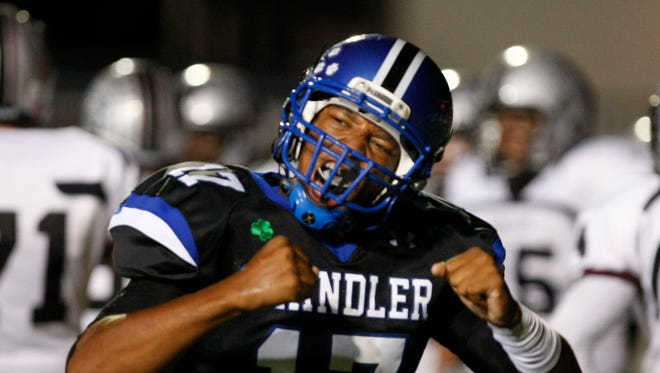 Chandler's Brett Hundley celebrates after scoring a touchdown against rival Hamilton.