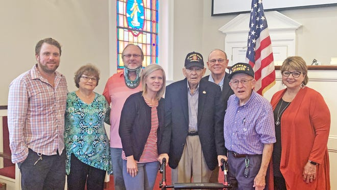 Riley Shelton Sr. (center) was honored during a special ceremony on Nov. 11 at Blackville First Baptist Church. He was recognized for his military service at the end of World War II. He's pictured with his family, including (from left to right): grandson, Luke Shelton; daughter-in-law and son, Lorraine and Steve Shelton; granddaughter, Ashlee Lemon; son, Riley Shelton Jr.; brother, Billy Shelton; and daughter-in-law, Debbie Shelton.