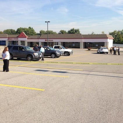 Police say an officer shot a suspect accused of stealing Tuesday morning in the parking lot of Kmart in south St. Louis County.