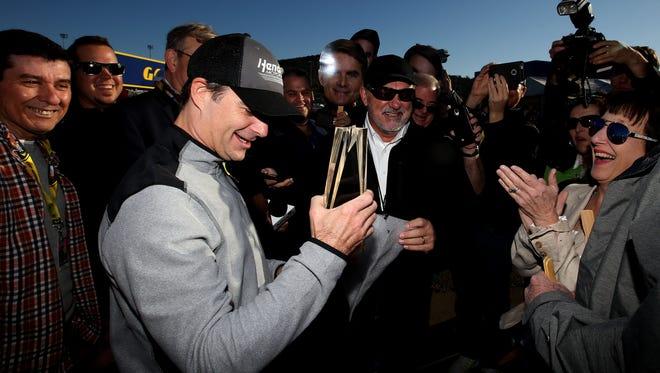 Jeff Gordon received a Kentucky Speedway trophy from media members.
