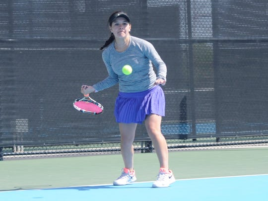 Wylie's Analeah Elias lines up a shot during the girls singles quarterfinals of the District 5-4A tournament at the Hardin-Simmons University Streich Tennis Center on Wednesday, April 4, 2018.