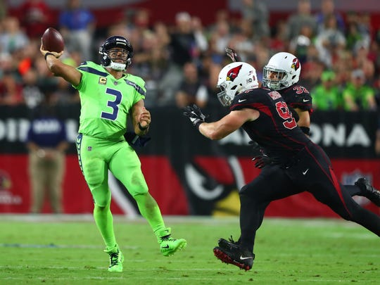 Seattle Seahawks quarterback Russell Wilson (3) throws a pass in the second half against the Arizona Cardinals during Thursday's game.