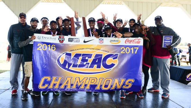 Maryland Eastern Shore's men's cross country team celebrates its third-straight MEAC title in Smyrna on Oct. 29, 2016.