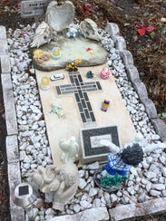 This memorial on the grave of Aden Ray Sanchez memorializes
