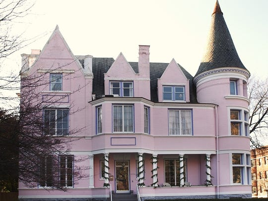 The Pink Palace in St. James Court, shown here all dressed up for Christmas, is being put up for auction.