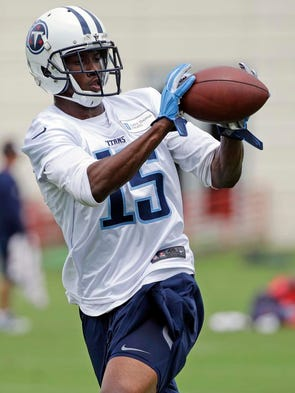 Titans wide receiver Justin Hunter catches a pass during
