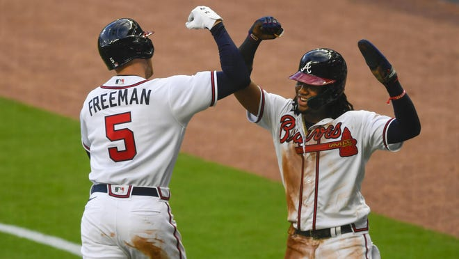 Atlanta Braves' Freddie Freeman (5) celebrates his two-run home run with Ronald Acuña during the third inning of a baseball game against the Tampa Bay Rays, Wednesday, July 29, 2020 in Atlanta.