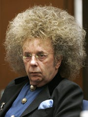 This July 24, 2013 photo released by the California Department of Corrections and Rehabilitation shows a photo of former music producer Phil Spector  smiling at the camera at the California Substance Abuse Treatment Facility and State Prison, in Corcoran, Calif. Two newly released photos of Spector show the toll of age and prison on the once flamboyant music legend. He is serving 19 years to life for the 2003 killing of actress Lana Clarkson. (AP Photo/California Department of Corrections and Rehabilitation)
