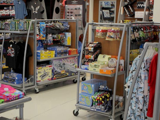 Some of the items for purchase at The Exchange Gift Shop at Page Field in Fort Myers include lawn ornaments and spinners with a plane like a B-51 or Bonanza. Also belts and watches with the wings.