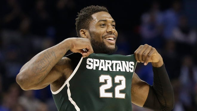 Michigan State's Branden Dawson celebrates after an NCAA tournament college basketball game against Virginia in the Round of 32 in Charlotte, N.C., Sunday, March 22, 2015. Michigan State won 60-54.