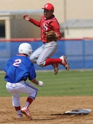 Cooper's Spencer Davis (2) steals second base in the