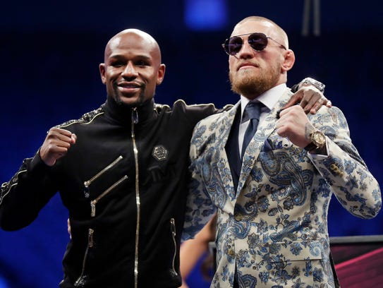 Floyd Mayweather Jr., left, and Conor McGregor pose
