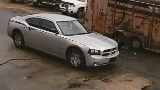 """The car is believed to be a 2006 or 2007 Dodge Charger with a black sticker on the side of the vehicle which reads """"High Output."""""""