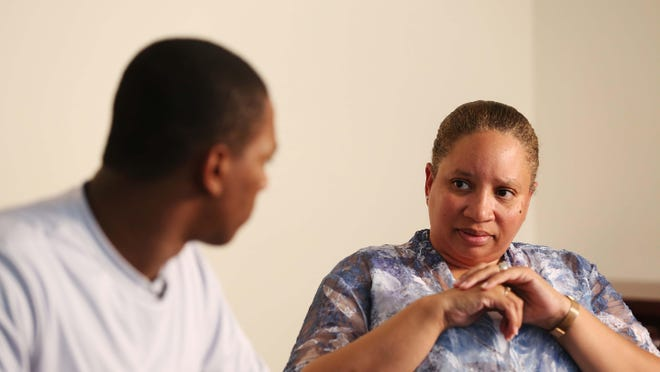 John Hawkins Jr., 18, of Des Moines with his mother, Ronnie Hawkins, talk about how John was stopped by police in late April, in a conference room at the Drake Legal Clinic on May 28.