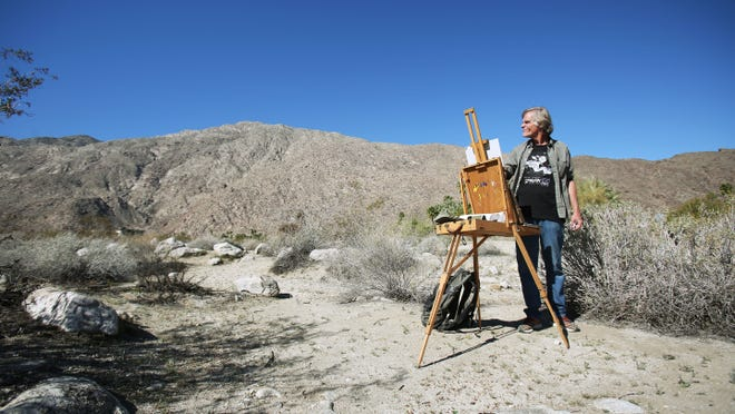 Painter Terry Masters paints the San Jacinto Mountains from Ramon Road on Wednesday, February 25, 2015 in Palm Springs, Calif.