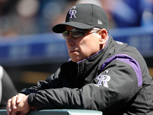 Colorado Rockies manager Bud Black leans over the dugout rail as he looks on against the Los Angeles Dodgers in the first inning of a baseball game Sunday, April 9, 2017, in Denver. (AP Photo/David Zalubowski)