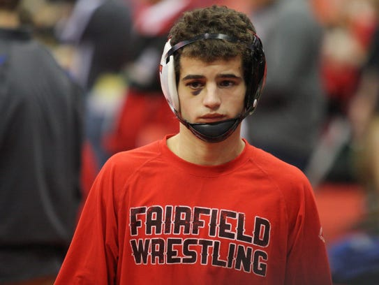 Fairfield's Zach Shupp gets ready for a 106-pound match