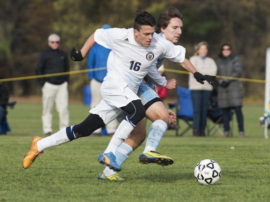 Essex's Tristan Salgado (16) runs is among the state's top forwards for the 2017 high school boys soccer season.