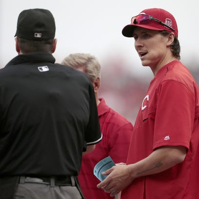 Homer Bailey delivers the Reds' starting lineup prior to the first inning.