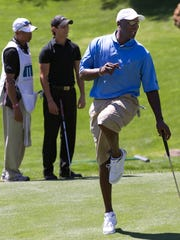 Michael Jordan reacts to his putt on the ninth green while playing in the Michael Jordan Invitational celebrity tournament March 31, 2011, in Las Vegas.