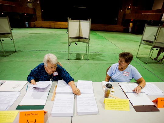 From left, election volunteers Clara Geist and Joyce LeBlanc organize primary ballots as they wait for voters at the Barre auditorium polling place Tuesday afternoon. By 4 p.m., barely 300 voters had cast their ballots out of nearly 5,000 registered voters.