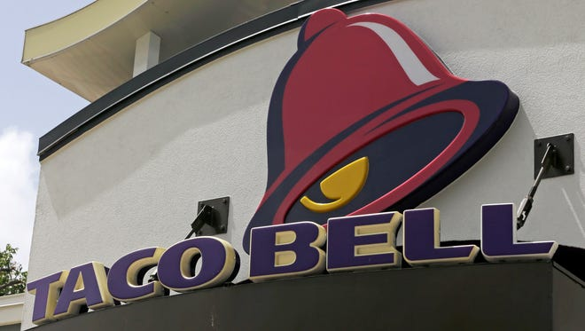 This Aug. 3, 2017, photo shows a Taco Bell sign at a restaurant in Hialeah, Fla.